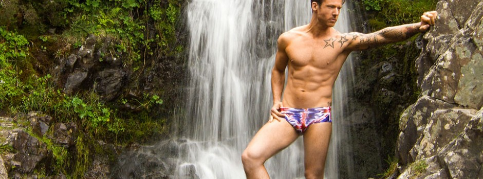 Mr Gay UK Stuart Hatton Jr at a waterfall in Body Art men's swimwear